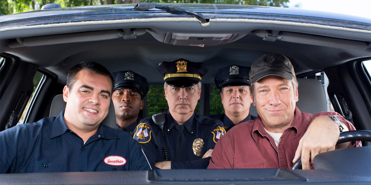 Mike Rowe and Police Officers in a car